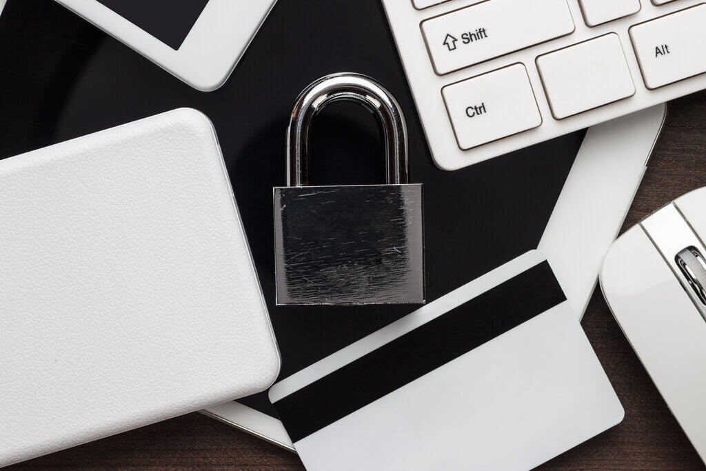 padlock on desk with different tech gadgets